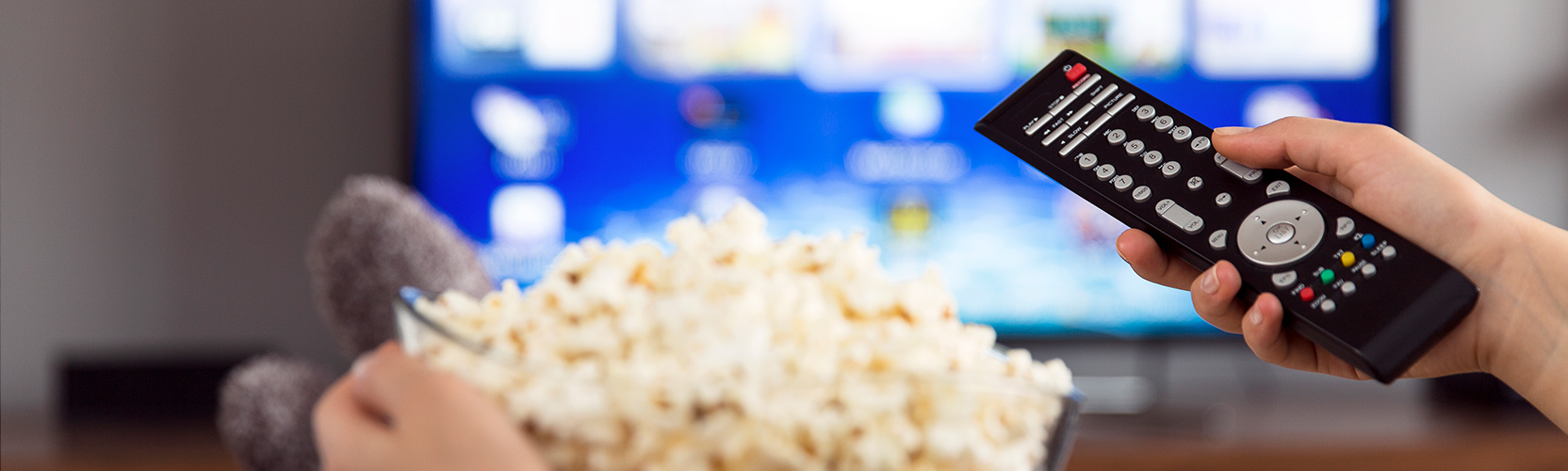 Digital video recorder pointed at a television with a bowl of popcorn