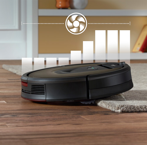 Roomba vacuum cleaner moving onto carpet