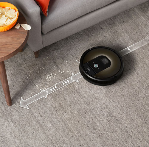 Roomba vacuum cleaner hoovering crumbs