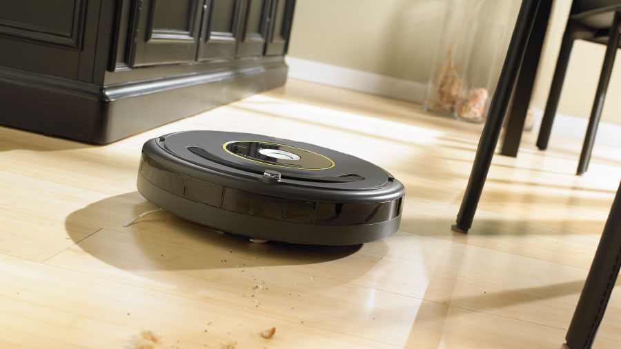 iRobot Roomba hovering over a wooden floor